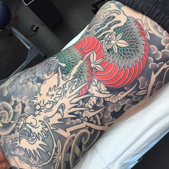 "Chipping away at this back piece featuring a dragon with maple leaves and lightning. This piece goes down on to the back of the thighs. But this last session was a ""pants on"" session @lighthouse_tattoo FOR BOOKINGS... w: lighthousetattoo.com.au e: contact@lighthousetattoo.com.au ph: (+61 2) 9316 4565"
