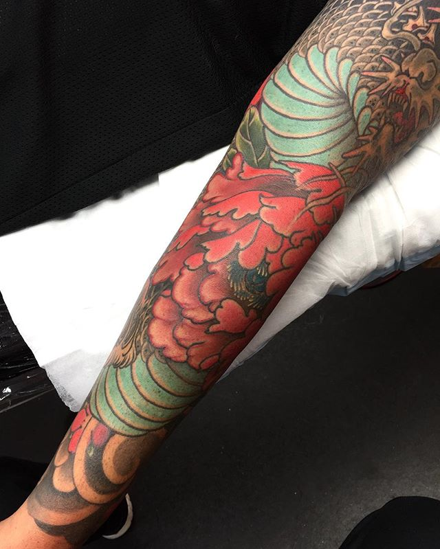 Here's a section of a sleeve I'm nearly finished featuring a dragon and peonies @lighthouse_tattoo FOR BOOKINGS... w: lighthousetattoo.com.au e: contact@lighthousetattoo.com.au ph: (+61 2) 9316 4565