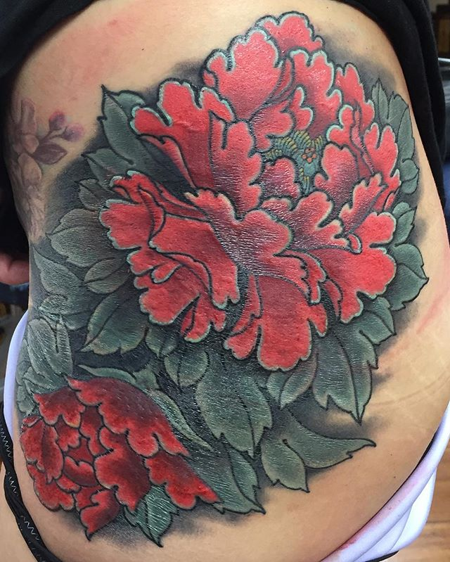 Peonies performing a massive cover up on the hip @lighthouse_tattoo . Some is fresh. Most is healed and a bit shiny. FOR BOOKINGS... w: lighthousetattoo.com.au : contact@lighthousetattoo.com.au ️: (+61 2) 9316 4565